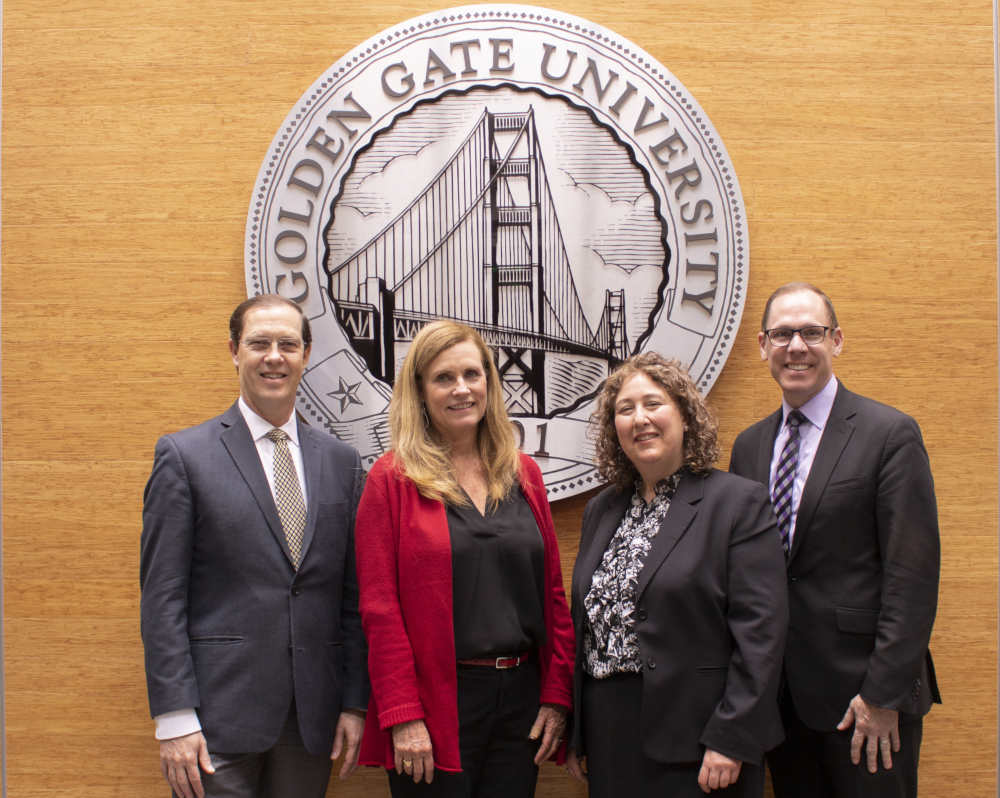 Bridging the law and business schools at Golden Gate University -- (from l-r): David J. Fike, PhD, GGU President; Barbara Karlin, JD, LLM, VP of Academic Affairs; Amy McLellan, Dean of the Braden School of Taxation and Director of the LLM Taxation and Estate Planning programs, and Anthony Niedwiecki, JD, LLM, Dean of the School of Law and Professor of Law.
