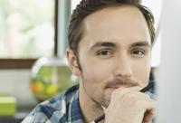 An entrepreneurial entrepreneur casts a pensive look.